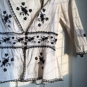 Black and white embroidered blouse